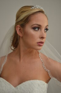 764 One tier fingertip veil with scallop beaded edge.