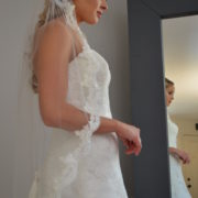 769 One tier fingertip veil with beaded lace edge.
