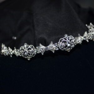 Filigreed rhinestone headband. Available in Silver and rose gold